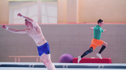 Gymnast acrobatic tumbling gymnastics exercises: somersault HD slow-motion video Footage