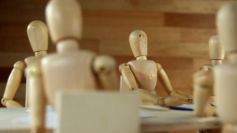 Wooden figurines having meeting in conference room Footage
