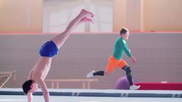 Gymnast tumbling gymnastics exercises: somersault HD video. Athlete flip salto Footage