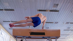 Gymnast doing routine exercises pommel horse HD video. Athlete training flairs Footage