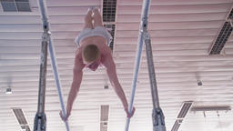 Gymnast performs routine parallel bars HD gymnastics video. Athlete training Footage