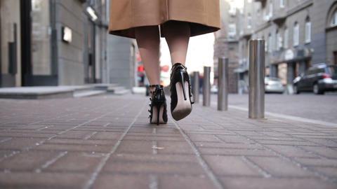 Woman wearing black high heels shoes walking away Footage