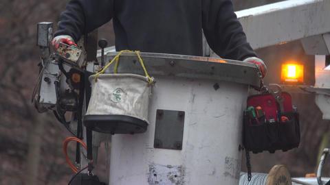 Detail shot of a man raising a utility bucket Footage