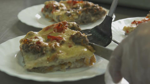 Closeup Freshly Baked Delicious Lasagna on White Plates Footage