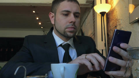 Using mobile phone on business lunch Footage