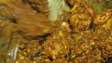 smoking hot Indian chicken curry being made Filmmaterial