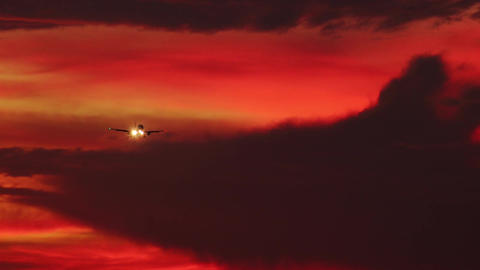 Gorgeous cloudscape with airplane. Flight of plane with flashing lights Live Action