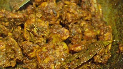 smoking hot Indian chicken curry being made Footage