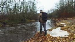 Slow motion of man fishing. Winter landscape Archivo