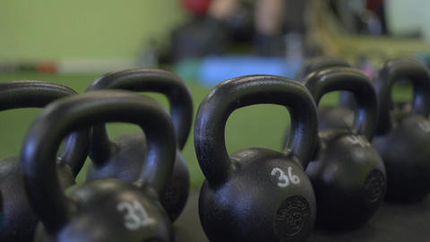 Shallow DOF shot of weights with man working out Footage