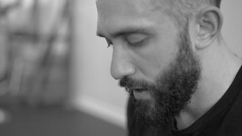 Sweating bearded man breathing hard after workout (B&W) Footage