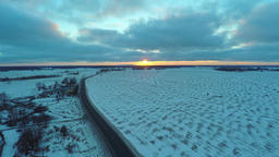 Aerial view of cars moving on winter road Footage
