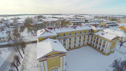 Old soviet school building. Winter city landscape covered with snow. Aerial foot Footage