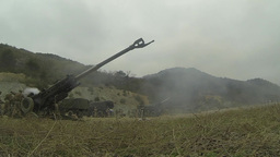 Artillery gun line firing for effect at SSang Yong 2014 Footage