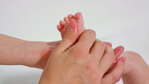 Mother Massaging Little Baby's Feet Footage