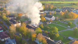 Burning house. Autumn city landscape. Smoke and fire. Aerial footage Filmmaterial