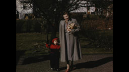 USA 1940s - 1950s: Mother and Child Outdoors Wearing Coats - Vintage Americana Footage
