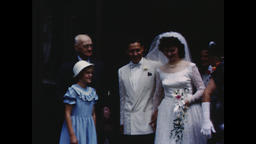 USA 1950s: Bride and Groom Exit Church, Guests Throw Rice - Vintage Americana Footage