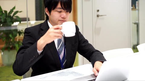 Employee who drinks coffee GIF