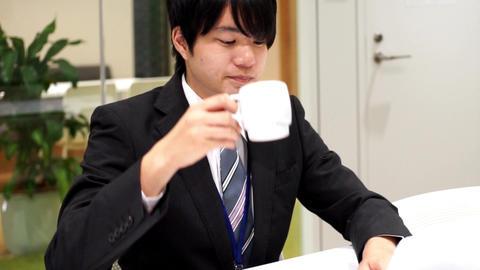 Employee who drinks coffee / pan Footage