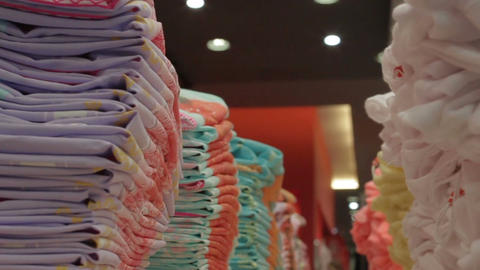 Closeup Lines with Neatly Folded New Bright Colors Clothes Footage