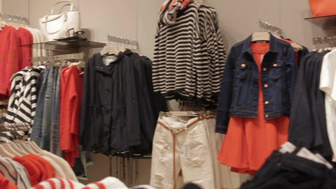 Motion Around at Fashion Store with Clothes Big Choice Footage