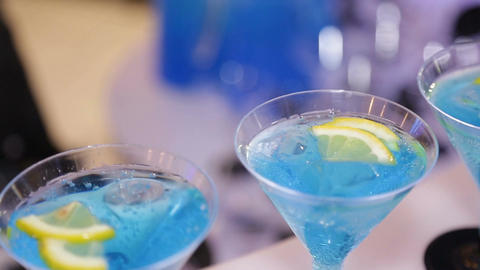 Closeup Barman Stands on Counter Glasses with Blue Cocktail Footage