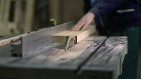 Carpenter working on electric saw cutting boards Footage