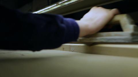 Carpenter working on fixed horizontal belt sander Footage