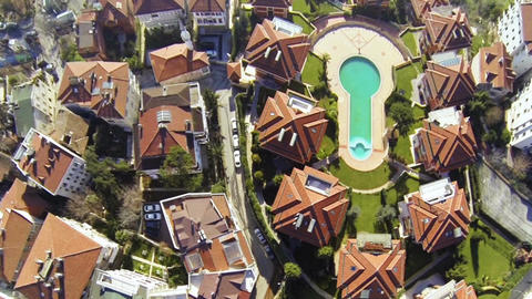 Aerial view down above residential housing with amazing rooftop architecture and