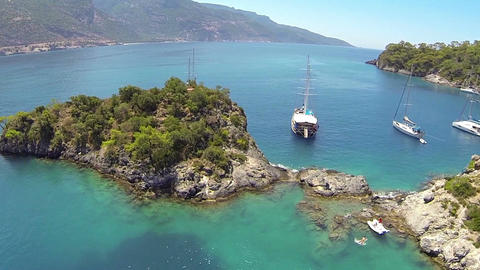 Flying over cruise yachts anchored at blue lagoon. Oludeniz Beach, Fethiye, Turk Footage