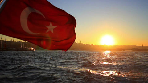 Turkish flag waving on the stern of an Istanbul ship at sunset Footage