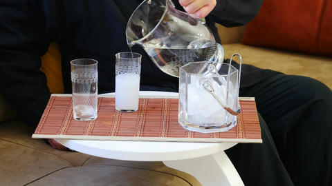 Pouring RAKI. In the bottle raki is absolutely clear Footage