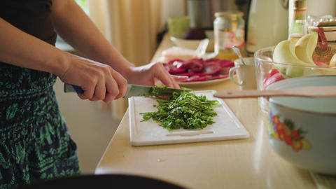 Woman Cuts Arugula Salad Footage