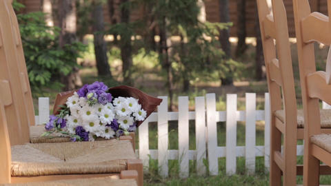 Bouquet Of Flowers On A Chair Footage