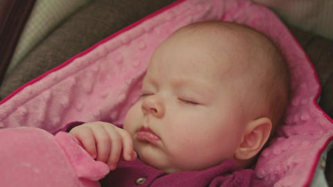 Peaceful Baby Sleeping in a Car Seat Footage