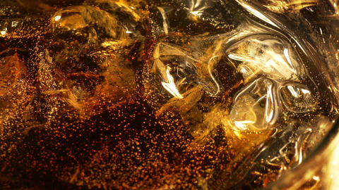 Two videos of cold Cola with ice cubes in 4K Footage