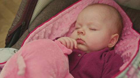 Beautiful Sleeping Baby in a Car Seat Archivo
