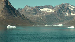 Greenland Prince Christian Sound 095 small icebergs in blue water of fjord Footage