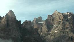 Greenland Prince Christian Sound 104 ship movement along rugged mountain ridge Footage