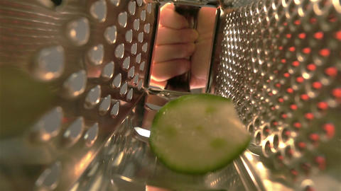 Three videos of grated cucumber in real slow motion Footage