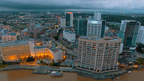 Aerial footage of the city along the river of Kuching, Malaysia Footage