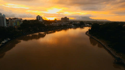 Sarawak River dyed in sunset, to a wide shot at dolly up Footage