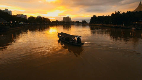 Sarawak River dyed in sunset, shot following the board Footage