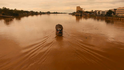 Sarawak River at sunset, Dolly In pursuing a boat Footage