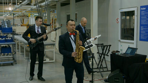 Three Caucasians Play Various Musical Instruments Footage