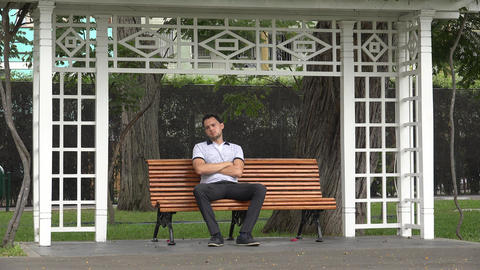 Lonely Man Sitting On Park Bench Footage