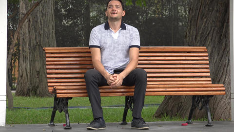 Happy Man Sitting On Park Bench Live Action