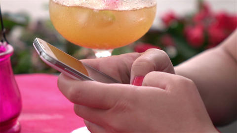Two videos of woman using mobile phone in real slow motion Footage