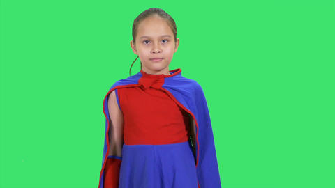 Young girl superhero flying on greenscreen front Live Action